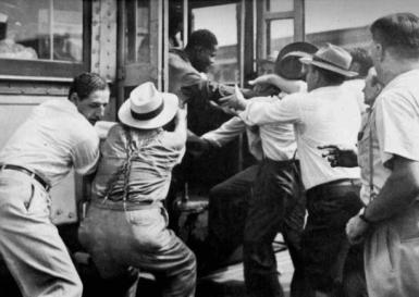 A-white-mob-attempts-to-abduct-a-black-man-Red-Summer-1919